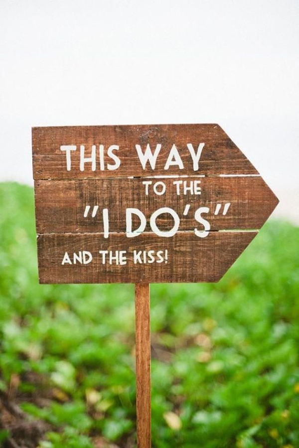 this-way-to-i-do's-and-the-kiss-wedding-ceremony-sign
