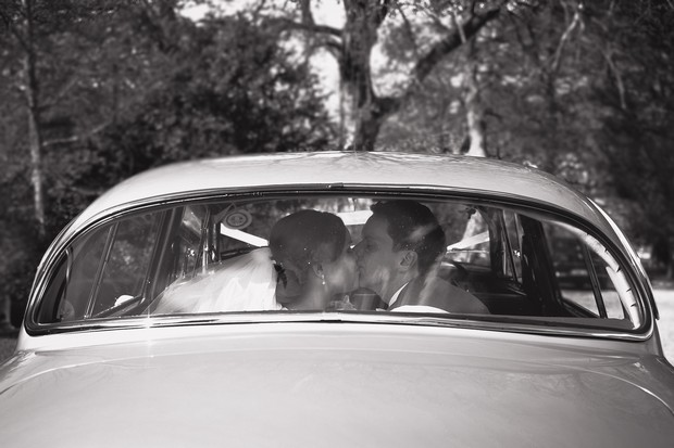 vintage-style-wedding-photography-bride-groom-kiss-car