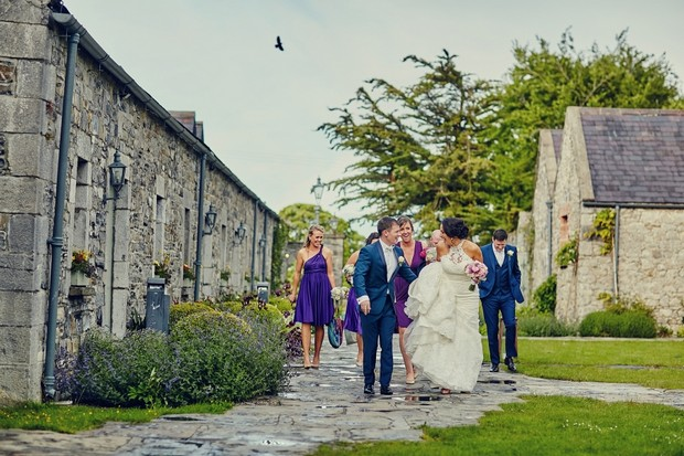 wedding-party-walking-to-photos-ballymagarvey
