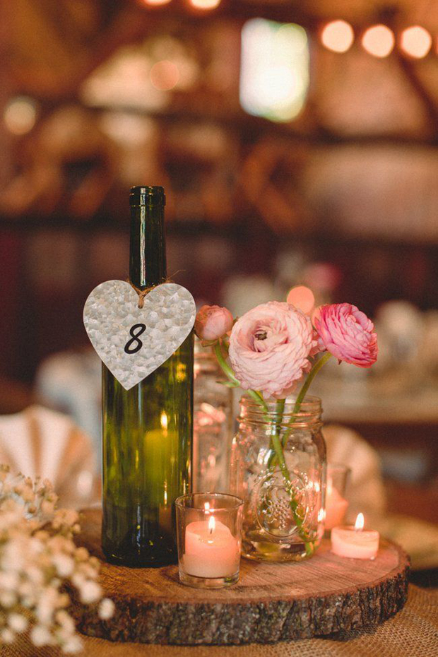 15 creative ways to use bottles in your wedding decor for Wine bottle ideas for weddings
