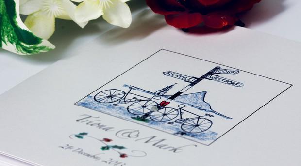 bicylce-signpost-wedding-incvite-on-silver-pond