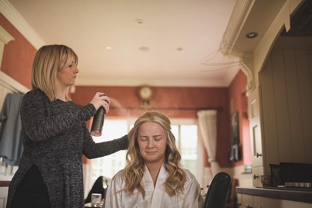bride-having-hair-done-home-kitchen-wedding-morning