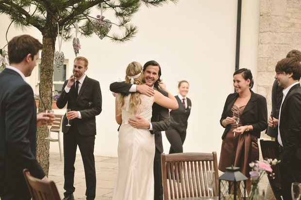 bride-hugging-groomsman