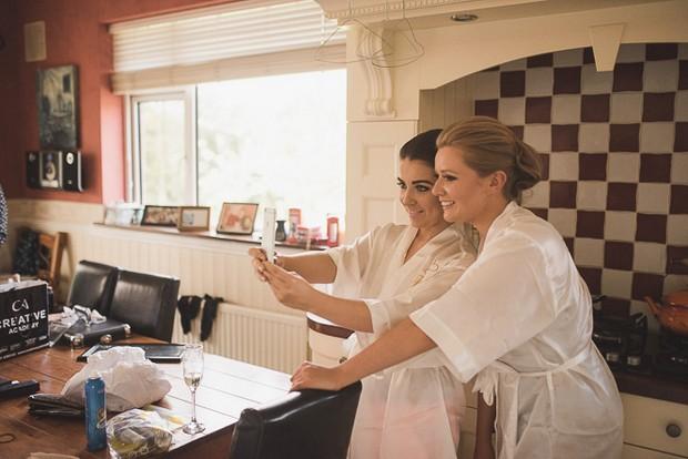 bridesmaids-taking-selfie-fun-morning-wedding-robes