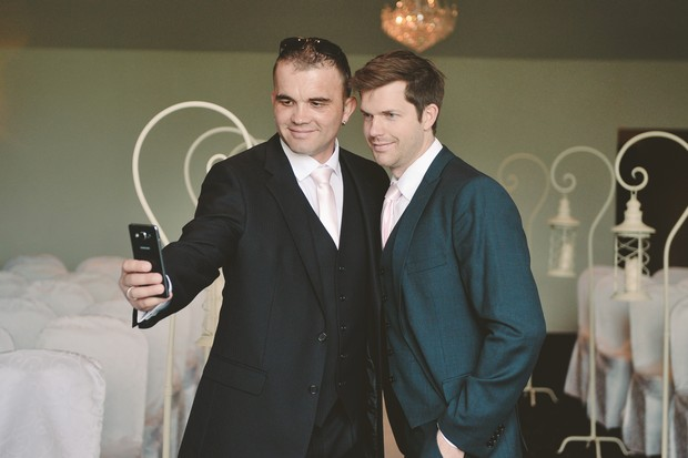 groom-groomsman-taking-selfie-waiting-bride