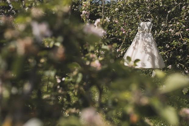 justin-alexander-wedding-dress-tea-length-hanging-outdoors
