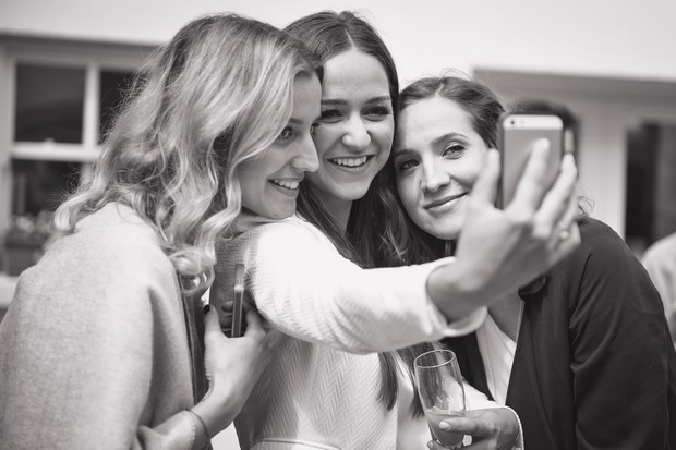 photo-of-wedding-guests-taking-selfies