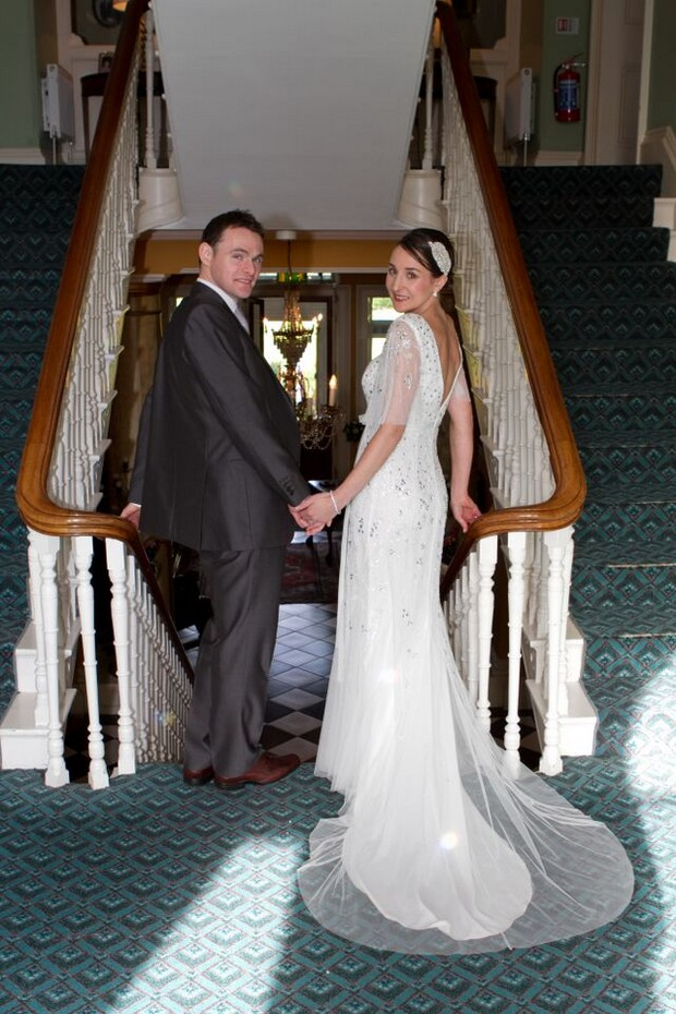 bride-and-groom-at-top-of-stairs-ballyseede-castle-kerry