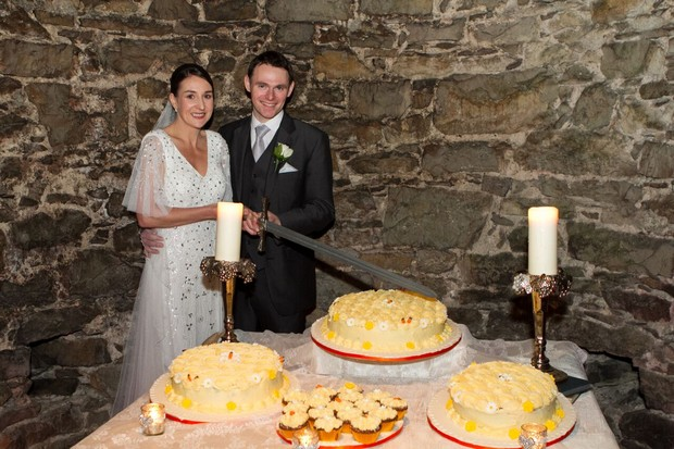 bride-and-groom-cutting-the-cake-real-wedding-kerry