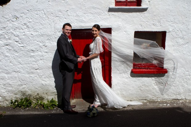 bride-and-groom-outside-old-cottage-kerry