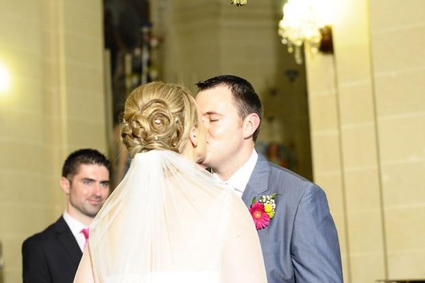 bride-groom-kissing-malta