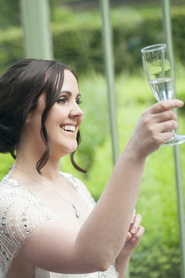 bride-toasting-glass-champagne