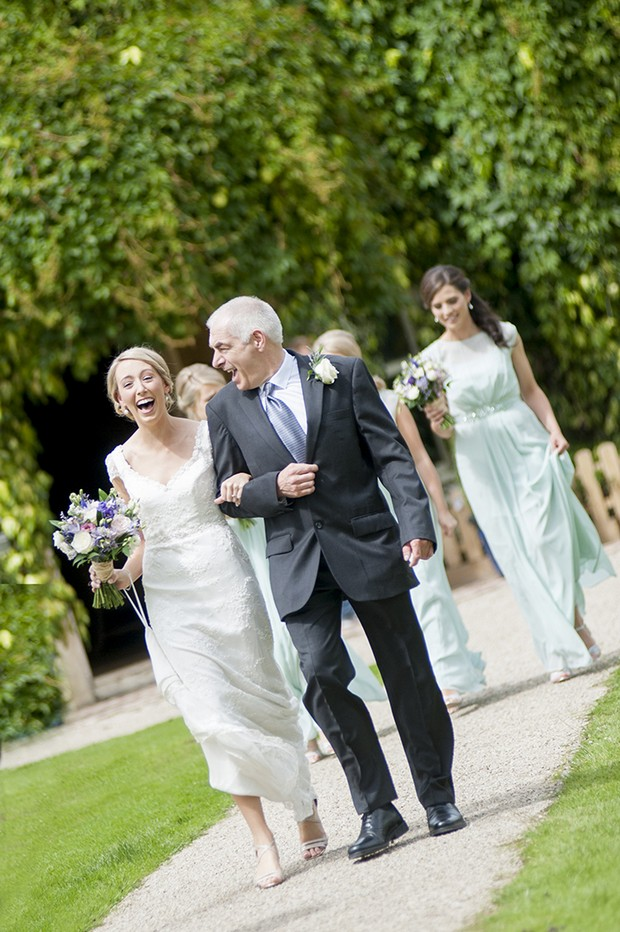 happy-bride-father-laughing-up-aisle