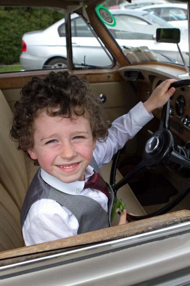 page-boy-in-wedding-getaway-car