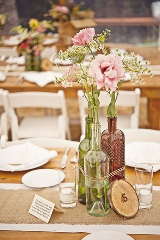 rustic-wedding-centerpiece-ideas-flower-filled-bottles-twine