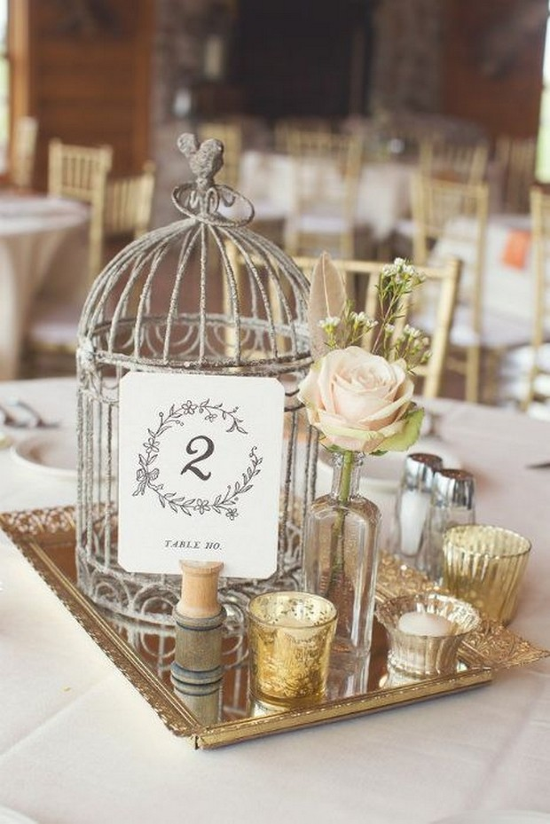 23 stunning rustic wedding centrepieces weddingsonline rustic wedding centerpiece ideas silver birdcage vases junglespirit Choice Image