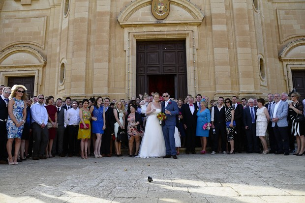 wedding-guests-outside-church-real-wedding-malta