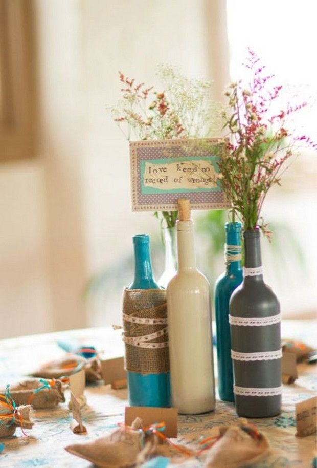 whimsical-festival-wedding-theme-centerpiece-rustic-wine-bottles-painted