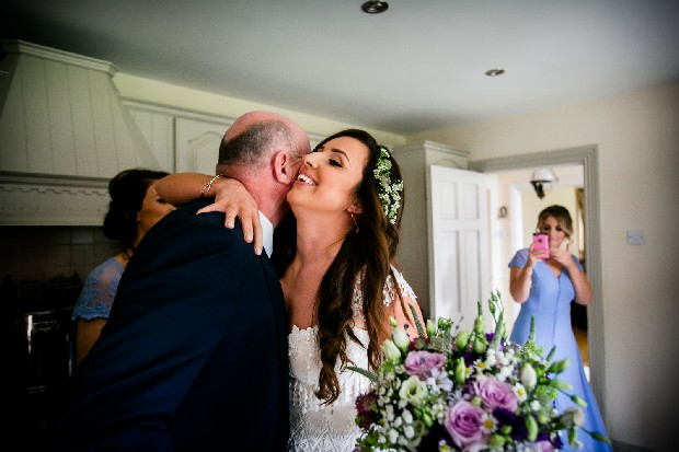 10-bride-hugging-father-first-look-photo