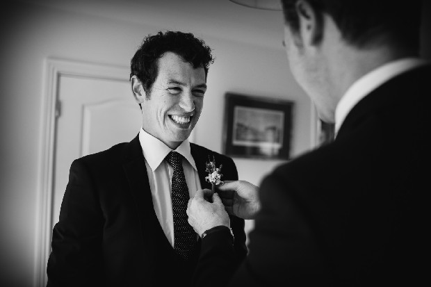 3-groom-getting-ready-boutonniere