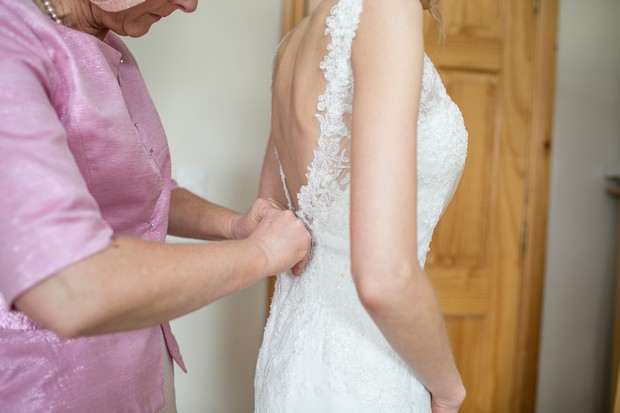 fastening-wedding-dress