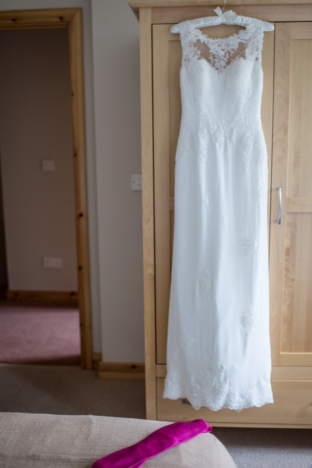 wedding-dress-hanging-up-lusan-mondongus