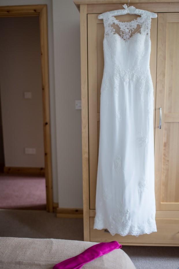 wedding-dress-hanging-up-lusan-mondongus