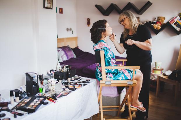 11-bride-having-make-up-done-morning-wedding