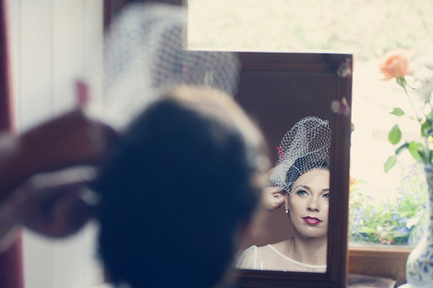 11-putting-veil-on-bride-mirror