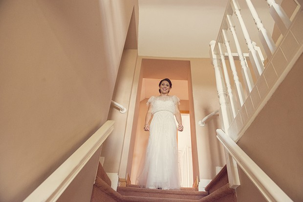 13-bride-on-staircase-home-morning