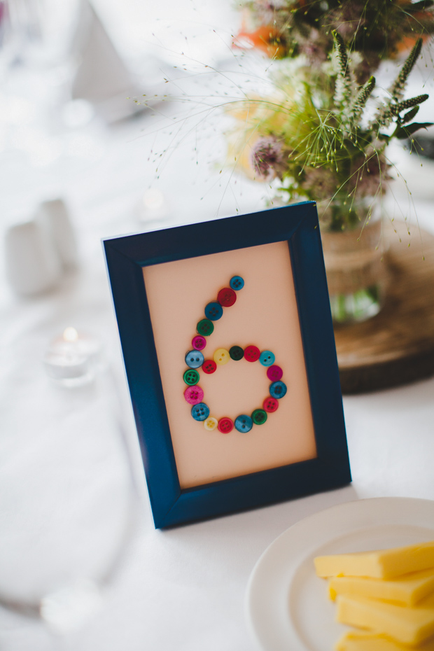 35-DIY-table-number-ideas-buttons-in-frame