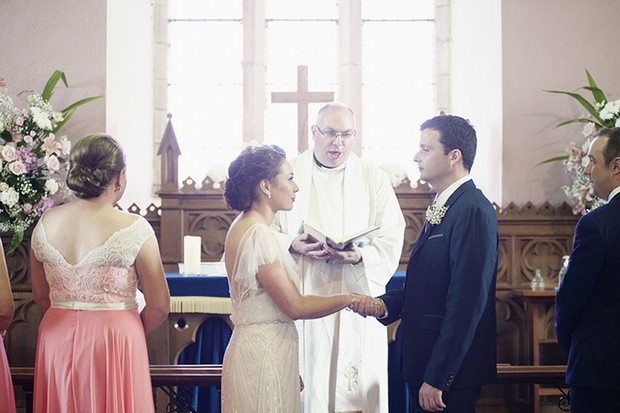 bride-groom-exchanging-vows-church-wedding