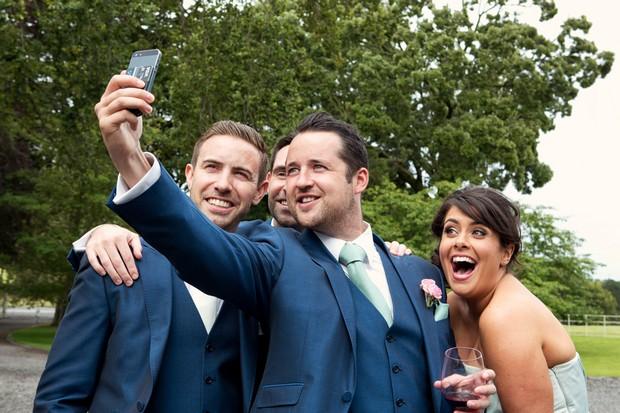 18_Bridal_party_taking_selfie