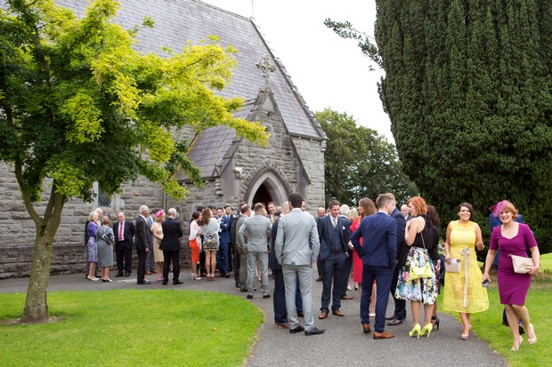 8-wedding-guests-gathering-outside-church