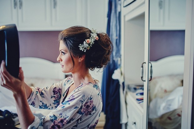 11-Bridesmaid-checking-hair-in-mirror