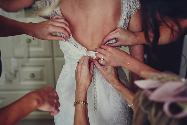 16-Hands-wedding-dress-fitting