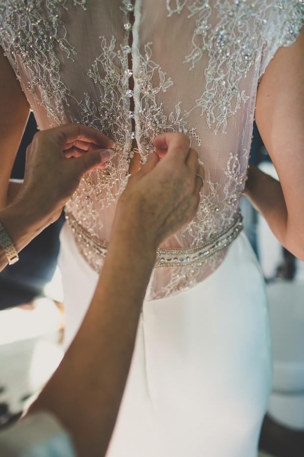 22_intricate_lace_back_wedding_Dress_badgley_mischka_fonda