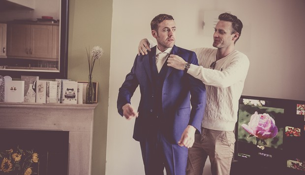 2_best_man_helping_groom_with_jacket