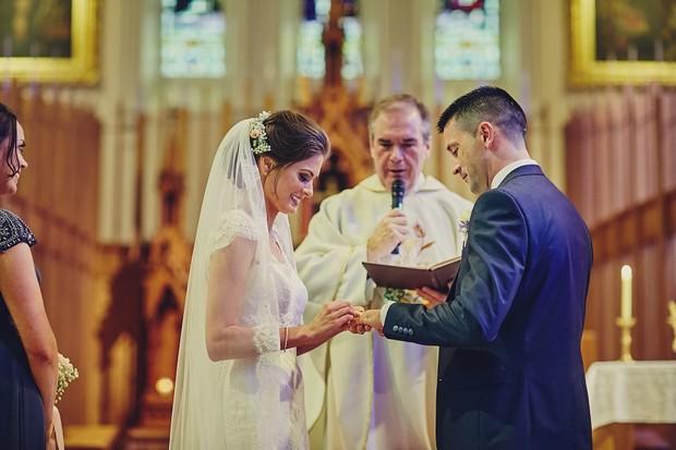33-bride-groom-exchange-rings-wedding-ceremony