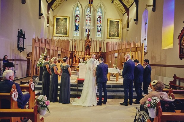 34-full-wedding-party-at-church-altar