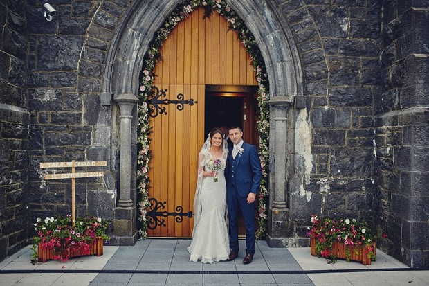 37-Floral-arch-wedding-church-couple