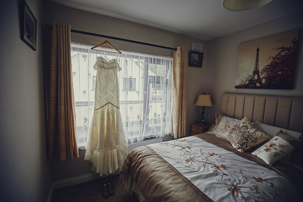 7-Wedding-Dress-Hanging-in-Bedroom-Window