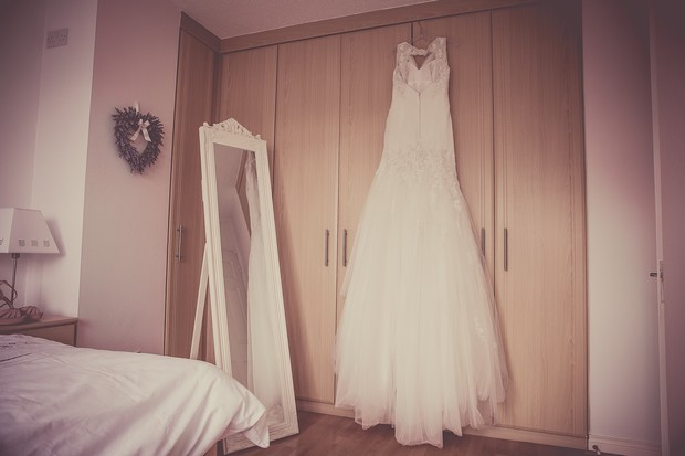 7_tulle_sophia_tolli_wedding_dress_hanging_real_bride