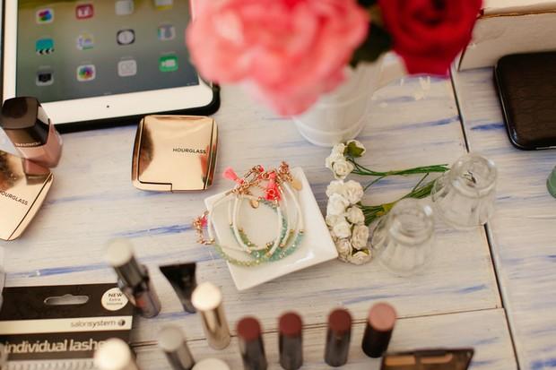 14-Make-up-table-roses-coral-beach-wedding-Matt+Lena-Photography