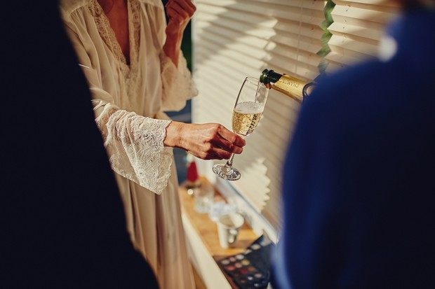 16-Bride-drinking-champagne-wedding-morning-family (2)
