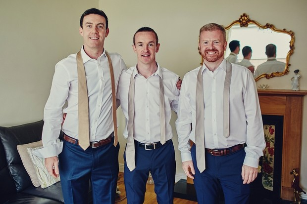 17-Groomsmen-getting-ready-wedding-morning-football (3)