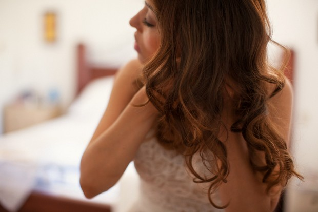 21-bride-putting-earrings-in-wedding-jewellery