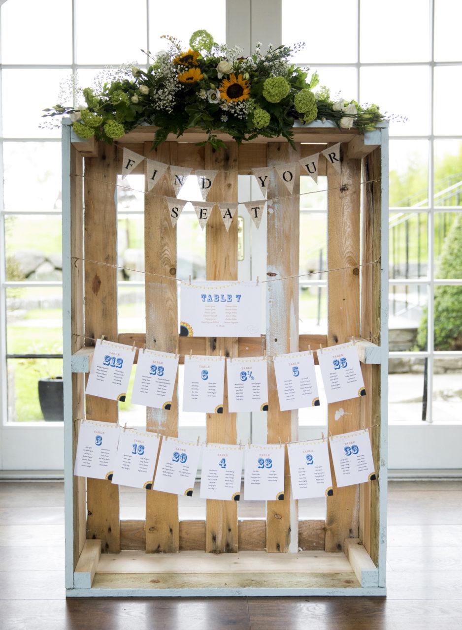 39-Rustic-Crate-Wedding-Table-Plan-Bunting-Wine-Corks