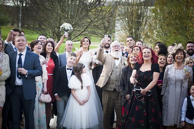 31-Group-Wedding-Photo-Cheers-Couple-photography