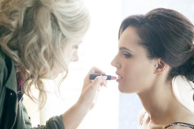 9-Bride-Applying-Lipstick-Wedding-Makeup